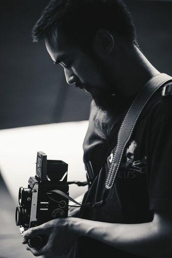 Close-up of a man holding camera
