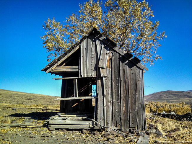 Abandoned & Derelict Architecture Beauty In Nature Blue Building Exterior Built Structure California Clear Sky Day Delapidated Desert Deserted Eye4photography  EyeEm Gallery Lobuephotos Mobilephotography Nature No People Outdoors Sky Smartphonephotography Sunlight Tree Weathered Wood - Material