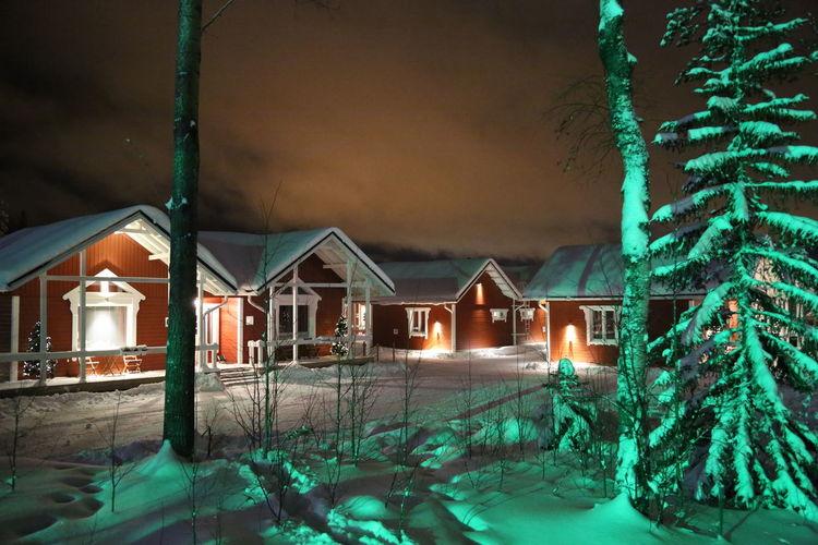 Hotels next to Santa Claus Village, Rovaniemi, Finland. Christmas Christmas Trees Hotels Pine Forest Rovaniemi, Finland Santa Santa Village Arctic Circle Condominium Night North Pole Outdoors Snow Winter Wonderland