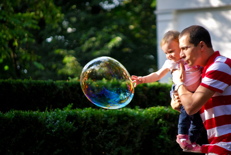 Boys Bubble Bubble Wand Bubbles Child Childhood Childhood Memories Father & Son Father And Daughter Fatherhood  Fatherhood Moments Fathers Day Fragility Fun Happiness Leisure Activity Mid-air Moment Moments Moments Of Life Playing Real People Togetherness