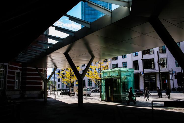 Empty railroad station platform seen through glass window