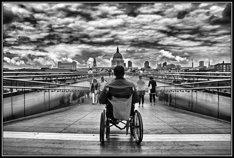 Homeless Architecture Homelessness  Cloud - Sky London Built Structure Rear View Building Exterior Sky Transportation Wheelchair Medical Equipment Auto Post Production Filter Transfer Print Bridge City Day Differing Abilities One Person Bridge - Man Made Structure Men Real People Outdoors