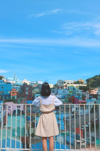 A Girl Love Myself  City Cityscape Standing Young Women Rear View Women Blue Beauty Sky Architecture Residential District TOWNSCAPE Human Settlement Rooftop Townhouse Old Town Residential Building Crowded Residential Structure Town Balcony Housing Settlement Settlement Horizon Over Water Urban Scene Exterior A New Beginning