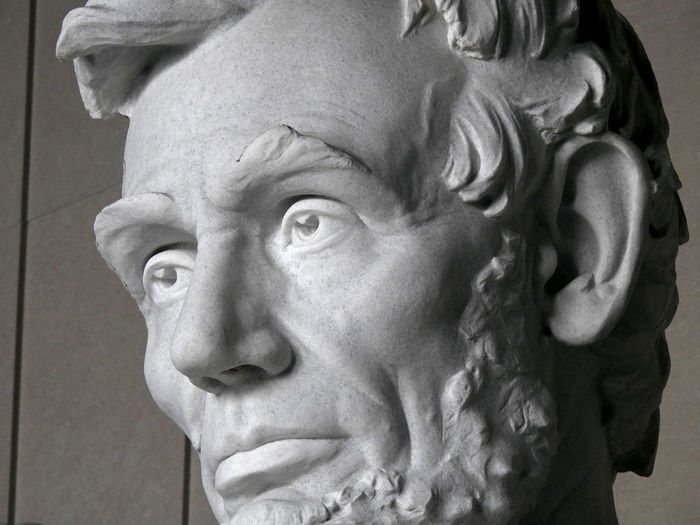 A close-up of Abraham Lincoln's face at the Lincoln Memorial in Washington, DC. Abraham Lincoln Statue American History Civil War Lincoln Memorial President Adult Close-up Day Human Face Human Representation Indoors  One Person People Portrait Sculpture Statue