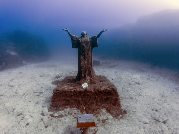 The statue of jesus christ near the wreck of the mv imperial eagle in malta