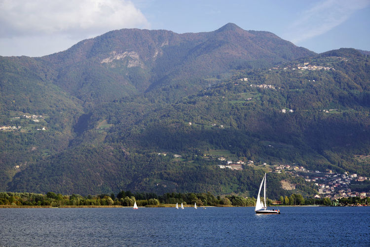 Iseo Lake at Lovere, Italy, Europe Nautical Vessel Transportation Water Mode Of Transportation Sailboat Nature Sky Sea Outdoors Iseo Lake Iseo Italy Yacht Yachting Yachting Sport Travel Travel Photography Landscape_Collection Lovere Lovere Italy Resort Landscape_photography Autumn Mountains Boat