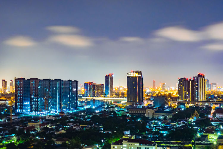Cityscape from high rise building at night with skyline and clouds. skyscraper in metropolis town with beautiful neon light Bangkok Thailand. City Night Skyline Sky View Cityscape Bangkok Thailand Travel Light Downtown Modern Panorama Road Town Twilight Landscape Building Skyscraper Architecture Evening Tower Tourism Business Beautiful Urban Asian  Landmark Street Neon Metropolis Nighttime Clouds Dark Scenics Dusk Capital Design Top Backgrounds Structure Illuminated Trails Building Exterior Built Structure Cloud - Sky Outdoors No People Urban Skyline Office Building Exterior