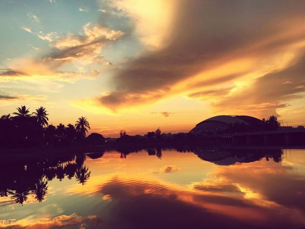 Dawn over National Stadium Reflection Water Sky Cloud - Sky Orange Color Waterfront Beauty In Nature Silhouette Scenics Tranquil Scene Outdoors No People Nature First Eyeem Photo The Great Outdoors - 2017 EyeEm Awards EyeEmNewHere