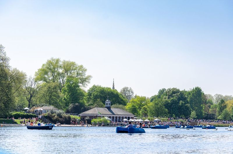 Boats on the serpentine lake at hyde park in summer, london