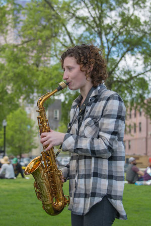 Day Focus On Foreground Leisure Activity Lifestyles Music Musical Instrument Musician One Person Outdoors People Performance Playing Real People Saxophone Tree Wind Instrument Young Adult Young Women