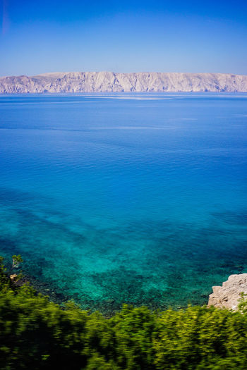 Blue ocean and mountain view Scenics - Nature Beauty In Nature Tranquil Scene Water Tranquility Land Nature Blue No People Day Sea Non-urban Scene Sky Idyllic Environment Landscape Mountain Clear Sky Travel Destinations Outdoors Blue Ocean Blue Sky