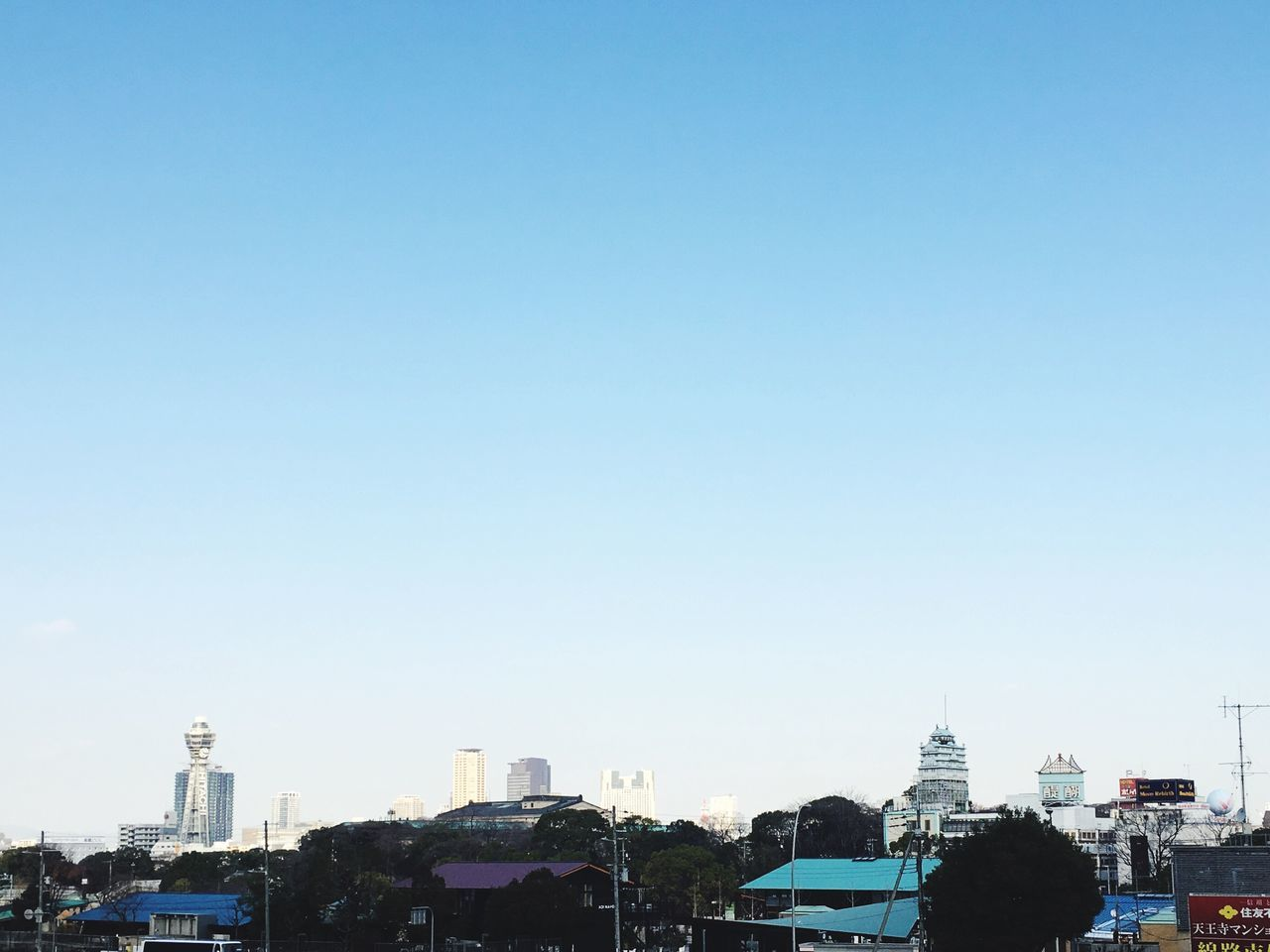 copy space, architecture, built structure, building exterior, clear sky, city, residential building, blue, outdoors, day, cityscape, no people, sky