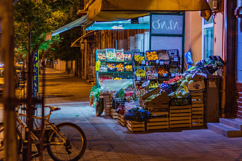 White bicycle Vegetable Night Pirot Street Shop Street Shop Street Photography Bike Bicycle Serbian Carts Cart Illuminated Vegetables Fruit Serbia Vegetable Carts Streets Of Pirot Lights Shoping Vegetable Shop Bikes Fresh Fruit And Vegetable Streets Fruit Carts Architecture Retail  City Text Store Communication Transportation Footpath Market Business Building Exterior Western Script Sign Built Structure Small Business Shopping Alley The Street Photographer - 2019 EyeEm Awards
