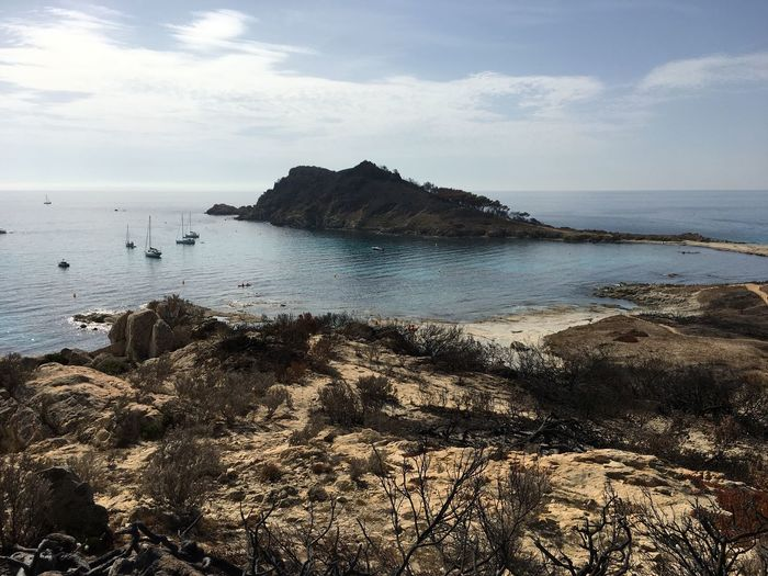 Sea Water Nature Sky Beauty In Nature Scenics Horizon Over Water Tranquility Tranquil Scene Beach Rock - Object Outdoors No People Day Fire Damage, Burned, Damaged, Destroyed, Garage