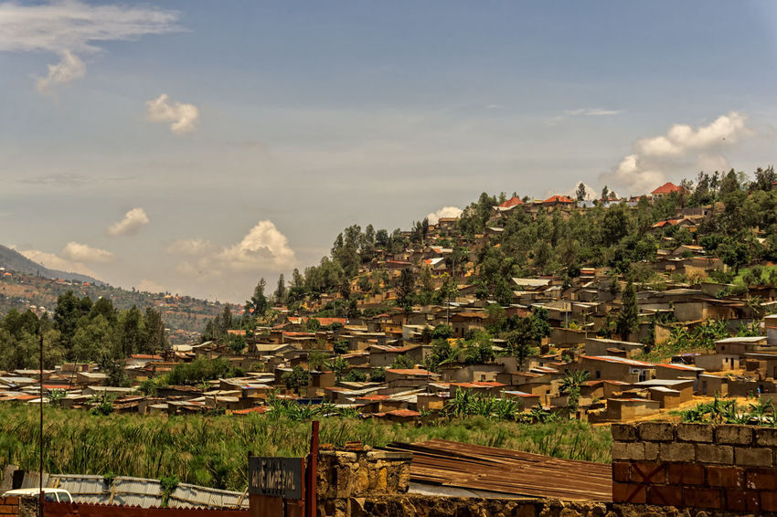KIGALI,RWANDA - OCTOBER 18,2017: Nyabugogo The view to an poor and old part of the city from KN 7 Road.It's on a hill and so one of the reasons why Rwanda is called the land of thounsand hills. Kigali Rwanda Africa Architecture Beauty In Nature Building Exterior Built Structure City Cityscape Cloud - Sky Day Mountain Nature No People Outdoors Scenics Sky Town Tree