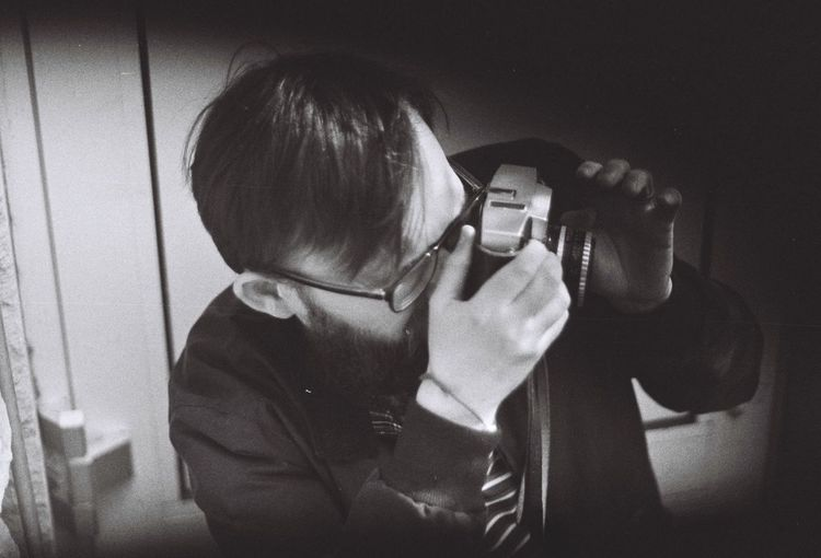 Close-up of boy photographing