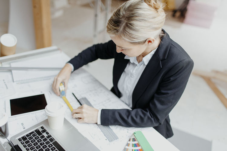 Confident businesswoman working at office