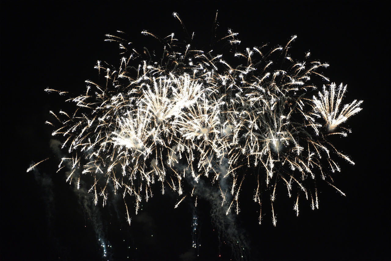 night, illuminated, exploding, firework, motion, arts culture and entertainment, firework display, celebration, long exposure, event, low angle view, nature, blurred motion, glowing, no people, sky, light, outdoors, firework - man made object, dark