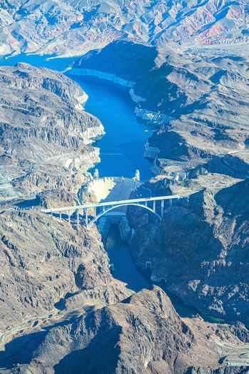 High angle view of snowcapped mountains and water - hoover dam