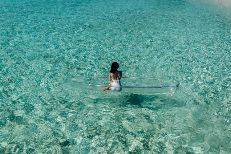 Semporna 男仔很忙 NikonD810 Water Real People Lifestyles High Angle View Leisure Activity One Person Day Women Nature Sea Rear View Beauty In Nature Waterfront Rippled Child Outdoors Swimming Pool Tranquility Turquoise Colored