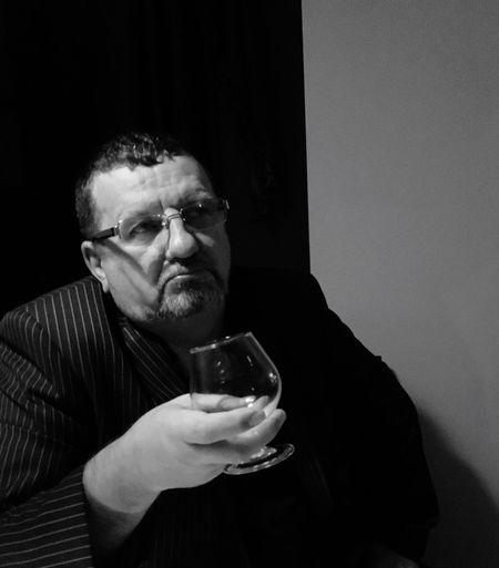 Thoughtful businessman holding wineglass