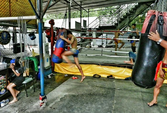The Color Of Sport MuyThai Boxing Skill  Practice Makes Perfect Full Length Lifestyles Side View Underpass City Life Togetherness Boys Girls Leisure Activity Safetyfirst