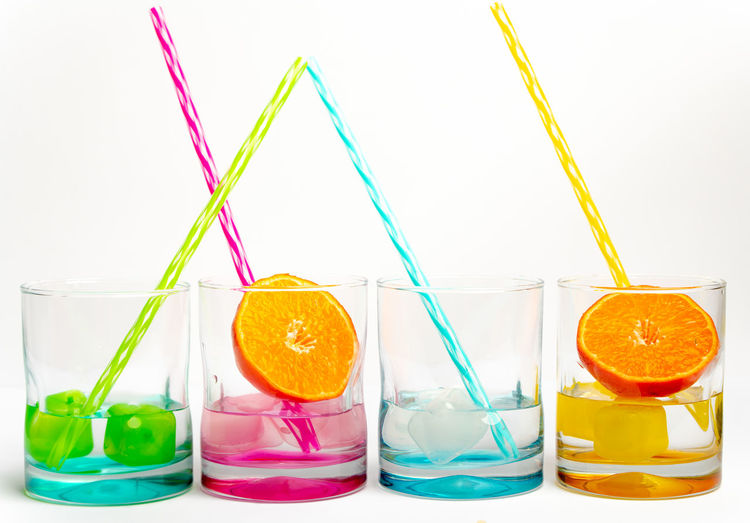 rainbow colors and vitamines Rainbow Colors Bright Colors Row Simplicity Drink Glass Summer Diversity Concept Healthy Lifestyle White Background Drinking Straw Multi Colored Variation Science Citrus Fruit Beverage Ice Cube