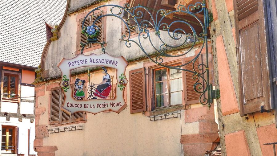 Looking up at beautiful facades in Kaysersberg, Alsace Façade Facades Window Windows Signs Wall Wall - Building Feature Wrought Iron Design Wrought Iron Art Village Village View Design Vintage