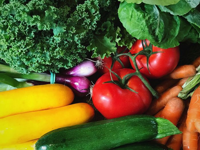 Fresh farm-stand produce. Tomatoes, zucchini, onions, carrots and greens. Vegetable Healthy Eating Freshness Food Raw Food Tomato Close-up Farmstand Organic Food Organic Farming Food And Drink Variation No People Green Color Red Indoors  Day