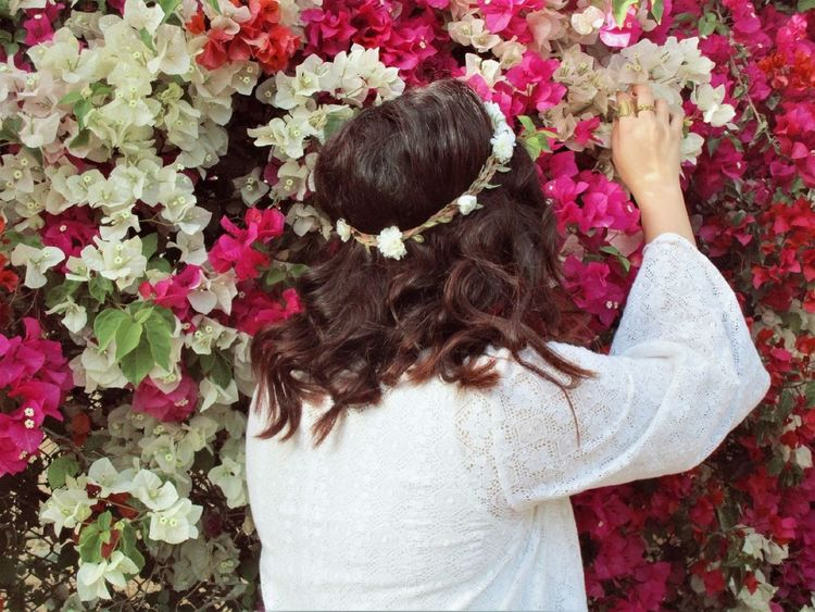 Flower Leisure Activity Lifestyles Outdoors Nature Girls One Woman Only Freshness Rear View Beauty Beautiful Woman Happiness Flower Photography Egypt Flowers,Plants & Garden Nature Tree Freshness Black Background Young Adult Growth AUC Plant