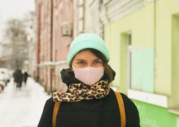 Portrait of teenage girl covered with snow