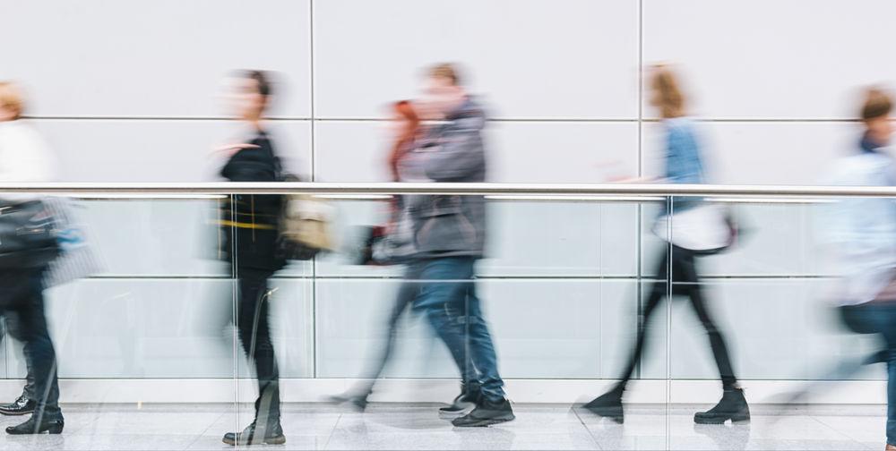 Blurred Motion Of People Walking On Walkway