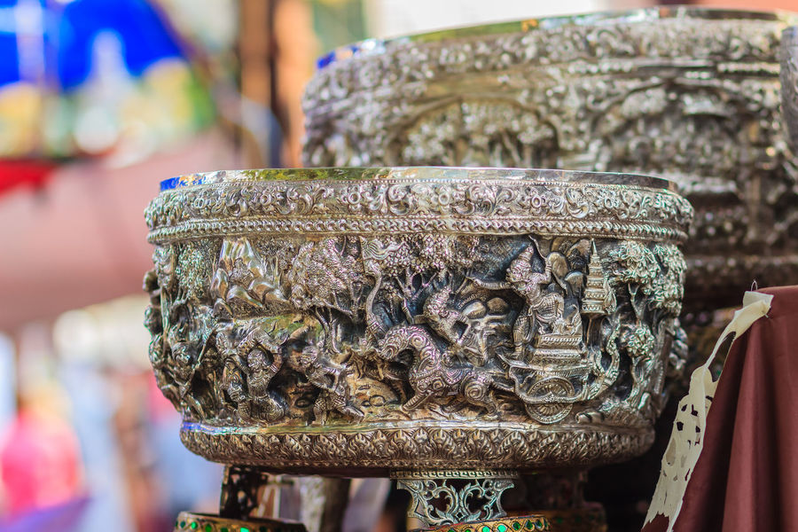 Beautiful Ancient Thai genuine silver bowl, retro engraved silverware, Beautiful genuine silver bowl handicrafts of Thailand Ancient Silverware  Souvenir Shop Art And Craft Close-up Day Focus On Foreground Genuine Silver No People Outdoors Retro Engraved Retro Style Retro Styled Sculpture Silver  Silver - Metal Silver Bowl Silver Bowls Silver Jewelery Silver Jewellery Silver Jewelry Souvenir Souvenirs Spirituality Statue