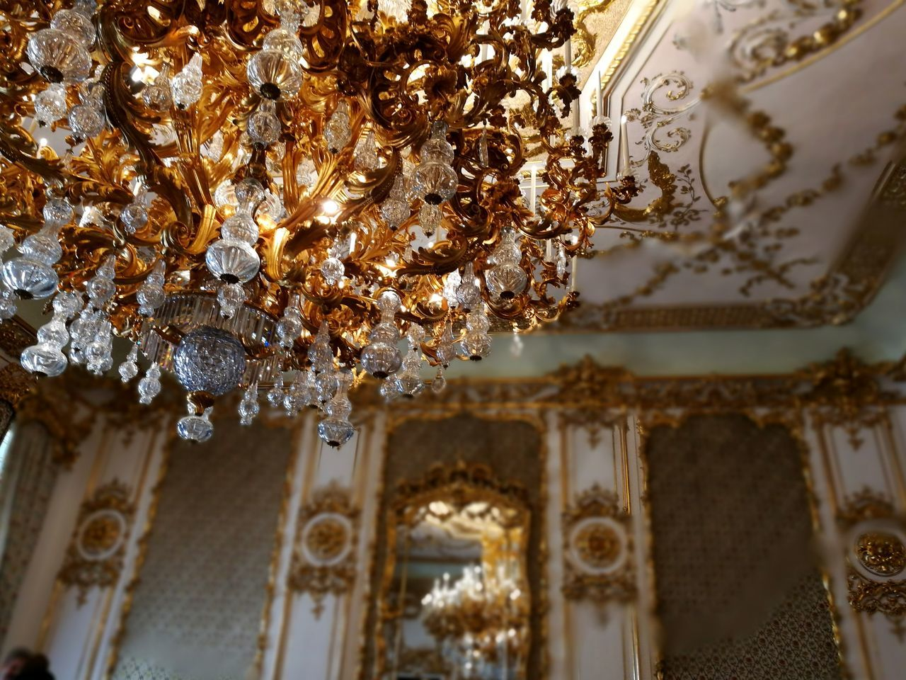 ceiling, low angle view, indoors, gold colored, built structure, no people, luxury, architecture, hanging, close-up, day