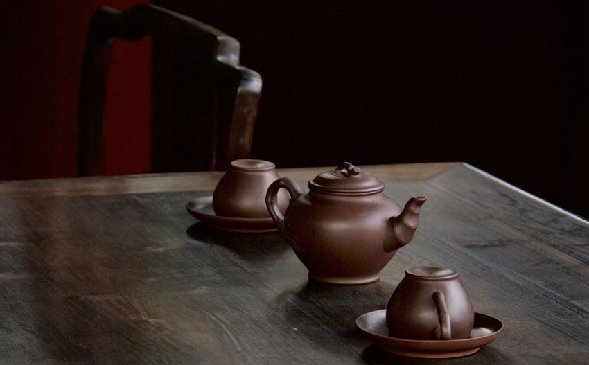 Cups With Teapot On Table