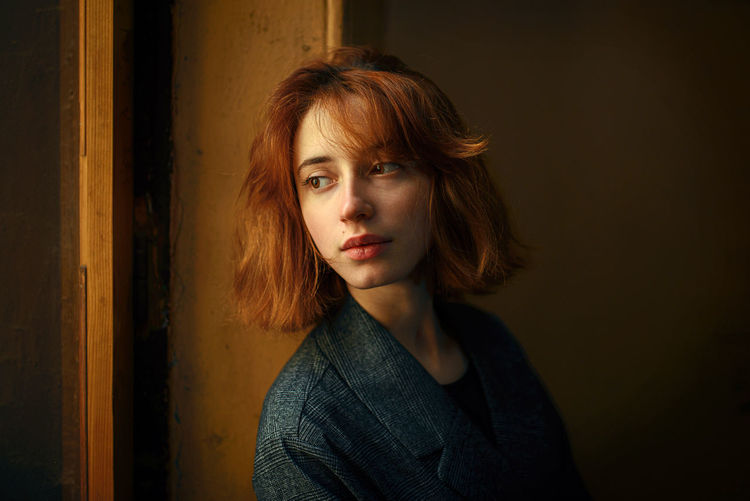 Portrait of woman against wall