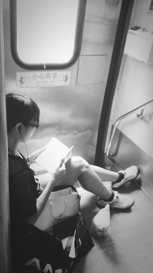 Taking Photos Girl Look At The Book On The Train Enjoying Life