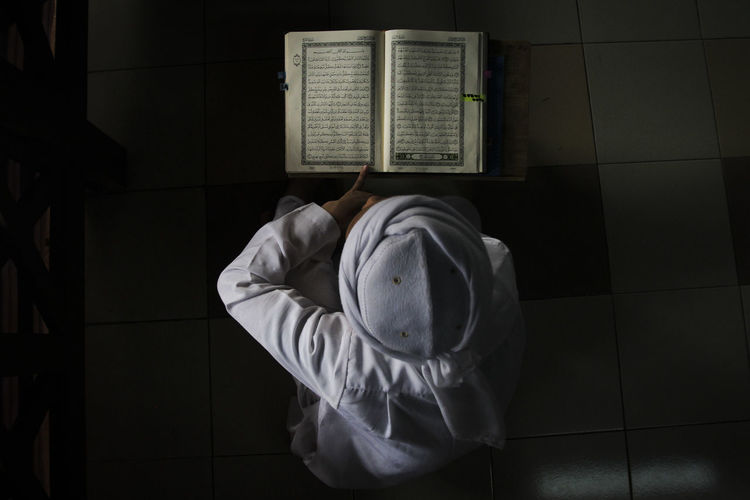 A Muslim boy read the Quran inside the Mosque during the holy month of Ramadan. Art Islam Islamic Malaysia Quran Quranulkareem Ramadan  Ramadan 2016 Ramadan Kareem Ramadan Mubarak Religion Religion School Religious Icons TAHFIZ
