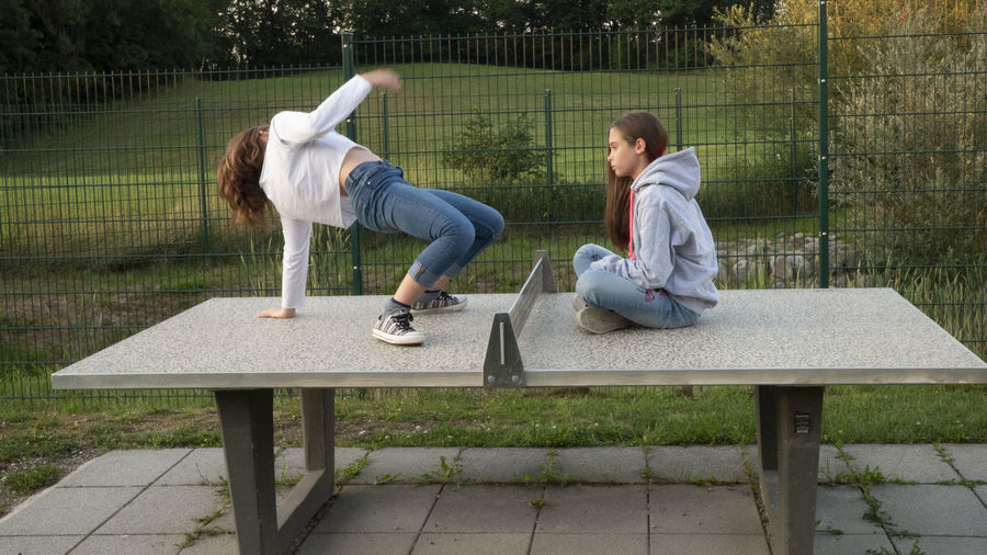 Girls on the table dance gymnastic gym fun first eyeem Photo Adult Bench Casual Clothing Child Couple - Relationship Day Emotion Females First Eyeem Photo Full Length Leisure Activity Men Nature Outdoors People Seat Sitting Sport Togetherness Two People Women Young Adult Young Women