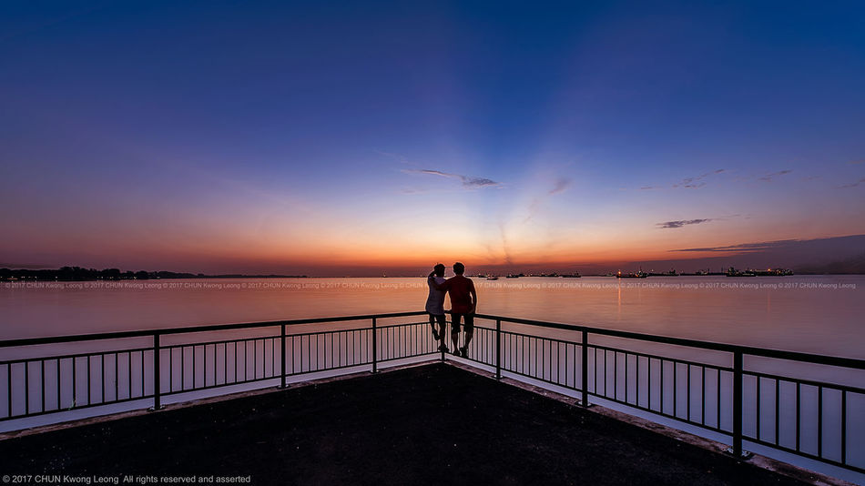 Side by side watching sunrise colours Bedok Jetty East Coast Park Outdoors Sea Singapore Standing Sunrise Sunrise_sunsets_aroundworld