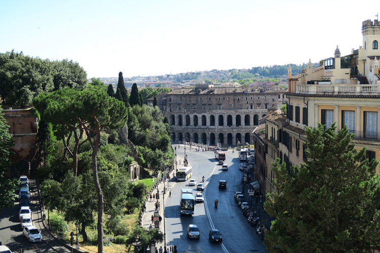 Rome Italy 18 June 2016. Theater of Marcellus view from Capitol Hill. The street named by the theater Via del Teatro di Marcello with tourists, traffic and public buses. Capital Cities  Cityscape Cityscapes Italia Italian Italy Mode Of Transport Roma Roman Roman Ancient Theater Rome Rome Capitol Rome Italy Rome Public Bus Rome Tourists Rome Traffic Streets Of Rome Theater Of Marcellus Rome Tourism Tourist Attraction  Tourist Destination Travel Destinations Travel Photography Traveling Via Teatro Di Marcello Moving Around Rome