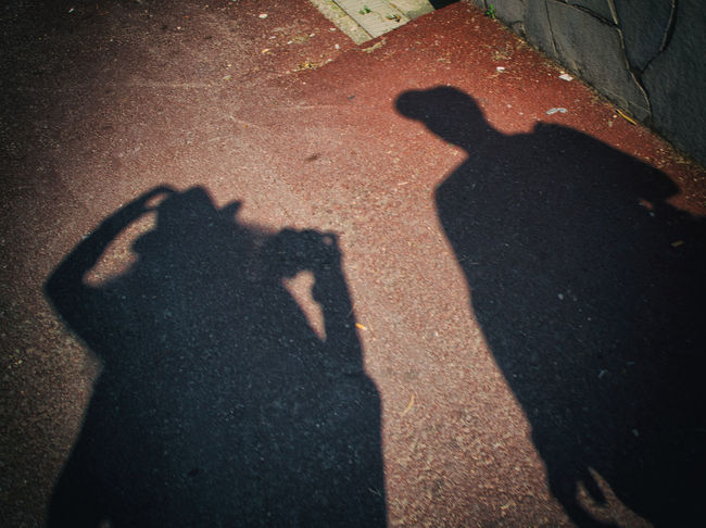 Adult City Couple - Relationship Focus On Shadow Gesturing High Angle View Leisure Activity Lifestyles Men Nature Outdoors People Photographer Photographing Photography Themes Real People Road Shadow Street Sunlight Togetherness