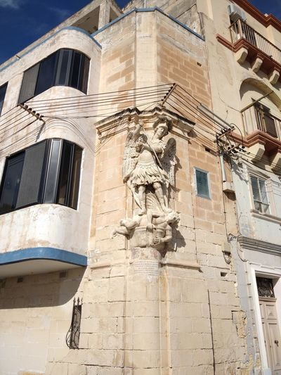 St. Michael Malta Senglea Architecture Building Exterior Art And Craft Representation Built Structure Statue Human Representation Sculpture Low Angle View Male Likeness Day The Past Outdoors St. Michael History Craft City