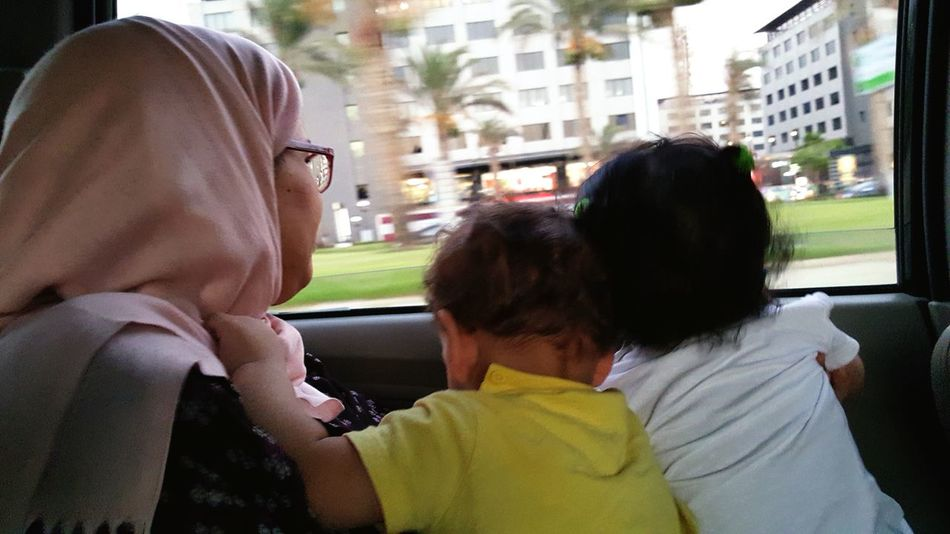 Mother & 2 kids.. Rear View Togetherness City People Two Kids Headshot Outdoors Day Cityscape Lifestyles Motherhood Moments Window Speed Love Bonding Real People Car Family❤ Woman Breathing Space The Week On EyeEm