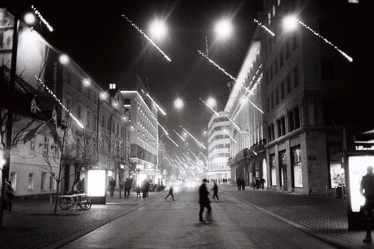 Night Illuminated Architecture Built Structure Building Exterior Street Light Real People City Men Outdoors People Adult Adults Only Only Men Slovenia Ljubljana Blackandwhite Black And White Black & White Blackandwhite Photography Black And White Photography Mobility In Mega Cities