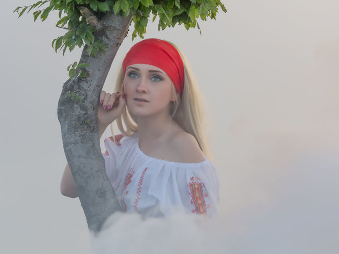 Lady Tree Attractive Beautiful Woman Beauty Blonde Hair Blouse Cheerful Contemplation Creative Dreamy Fashion Leisure Activity Lifestyles Looking Magic Model Portrait Red Scarf Sexygirl Smiling Traditional White Smoke Young Adult Young Women