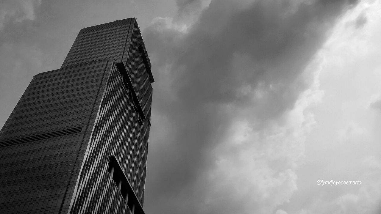 low angle view, modern, building exterior, sky, architecture, built structure, cloud - sky, skyscraper, day, outdoors, no people, city