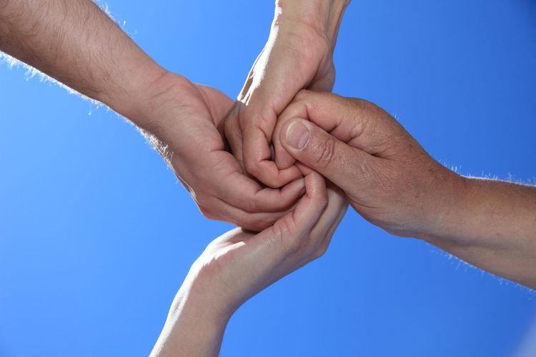 Hands showing gesture of teamwork Amity Blue Sky Friends Friendship Gesture Hands Loyalty Metaphor Solidarity Symbol Symbolic  Team Teamwork Togetherness