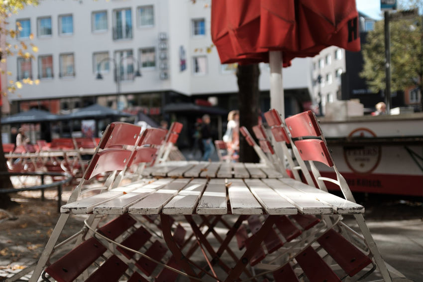 Architecture Building Building Exterior Built Structure Car Chair City Close-up Day Focus On Foreground Incidental People Outdoors Red Seat Table Twodayscologne