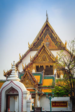 Beautiful roof gable and entrance gate of Wat Suthat temple, Thailand. Wat Suthat Thepphawararam is a royal temple of the first grade in Bangkok. Construction of the temple was completed in 1847. Entrance Gate Gable End Wat Suthat Wat Suthat Thepwararam Architecture Belief Building Building Exterior Built Structure Clear Sky Day Gable Gable Roof Gable Temple Naga Low Angle View Nature No People Outdoors Place Of Worship Religion Roof Roof Gable Roof Gables Royal Temple Sky Spirituality Tourism Travel Destinations